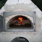 Steinbackofen, Brotbackofen: Backraum mit Feuer
